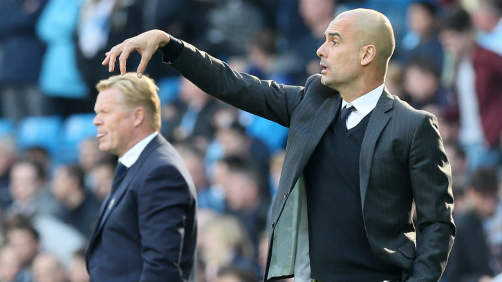 CALLING THE SHOTS: Manager Pep Guardiola and Ronald Koeman