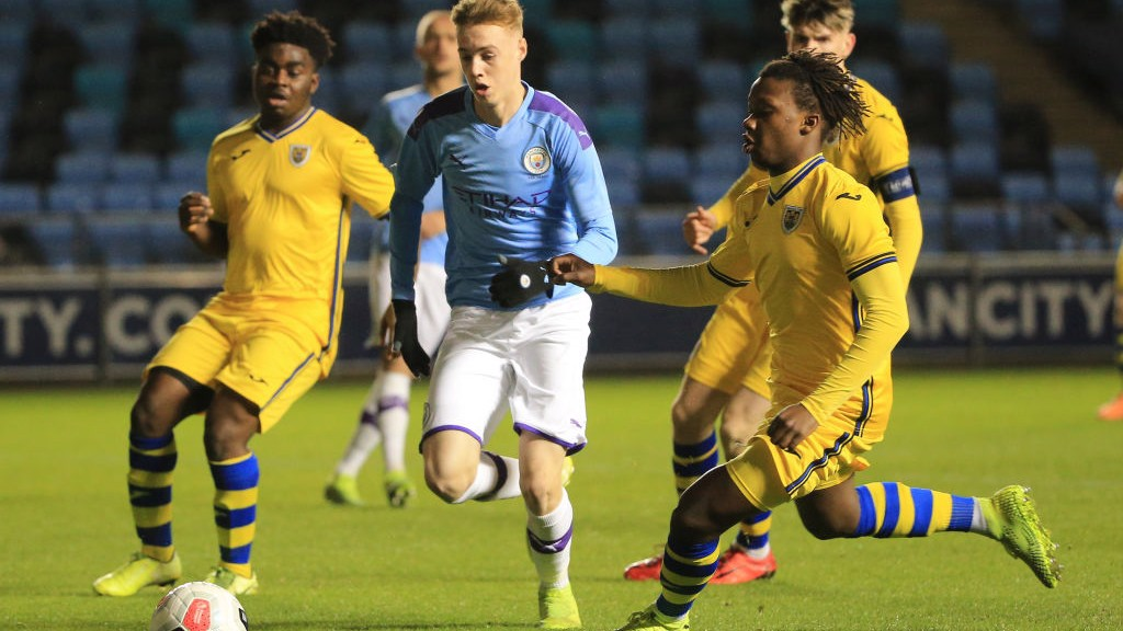 BATTLING: Cole Palmer gives chase against Swansea.