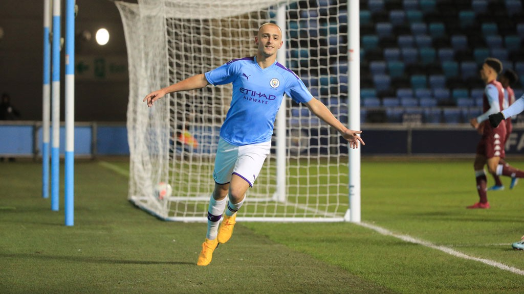 STRIKE ONE: Lewis Fiorini wheels away in celebration after his opening goal
