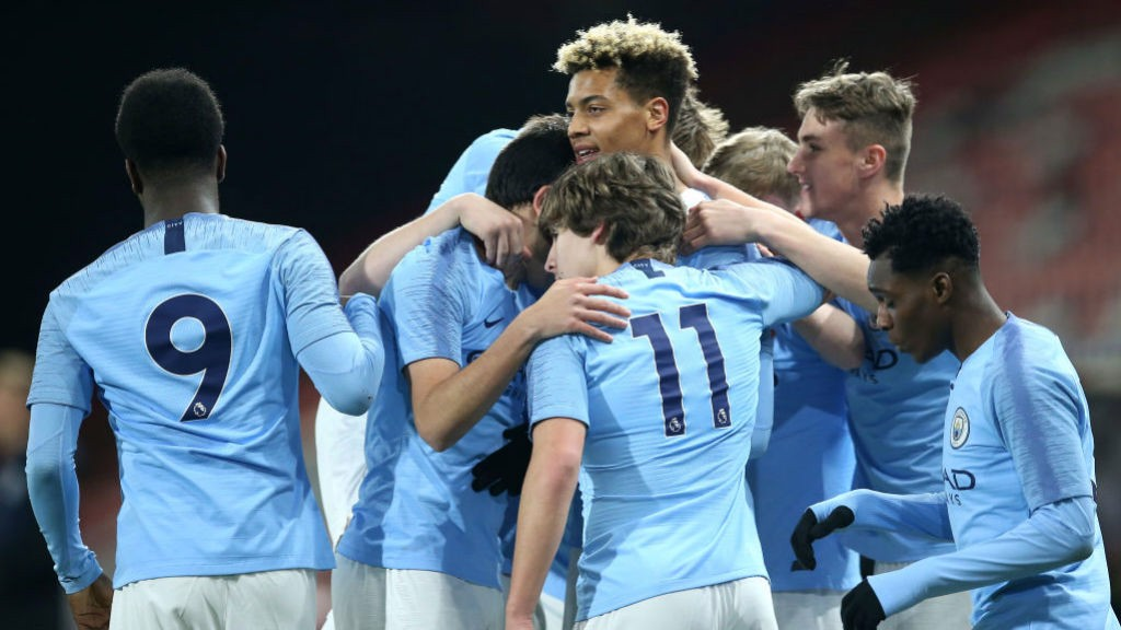 SQUAD: The young Blues celebrate after Felix Nmecha's opener.