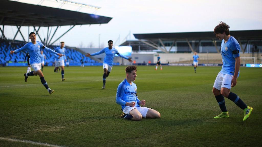SLIDE RULE: Ben Knight celebrates after netting City's opener