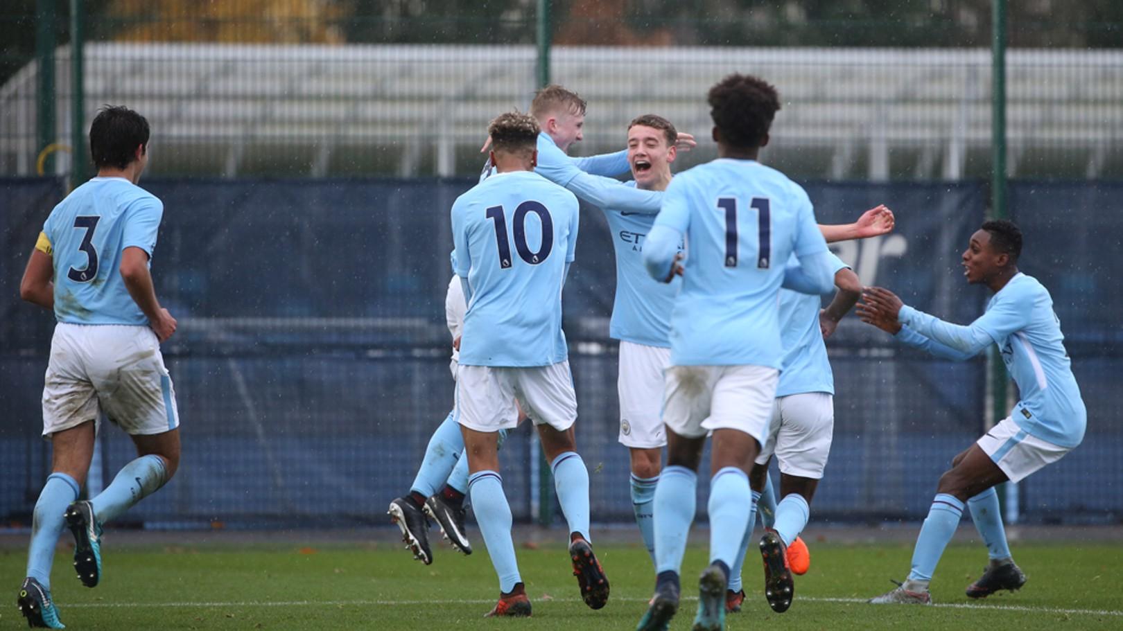 STRIKE: Colin Rosler celebrates scoring against Manchester United U18s.