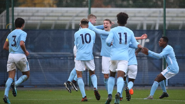 STRIKE: Colin Rosler celebrates scoring against Manchester United U18s.
