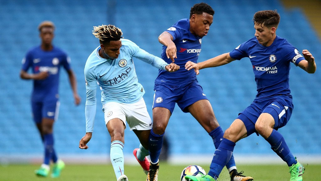 Action Shot City Eds Battle It Out At The Etihad Stadium
