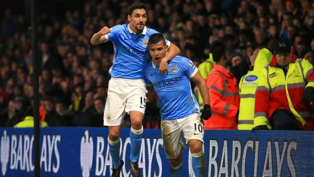 WHAT A FEELING: Jesus Navas celebrates with Sergio Aguero