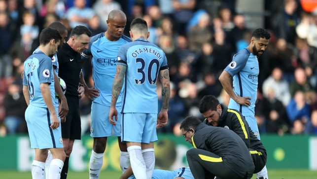 CONCERN: The players look on as Aguero receives treatment following a heavy challenge from Tadic.