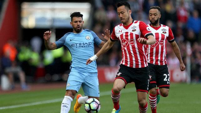 PRESSURE: Aguero and Yoshida battle for the ball.