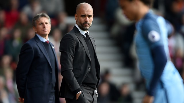 WATCHING ON : Pep Guardiola and Claude Puel look on from the touchline.