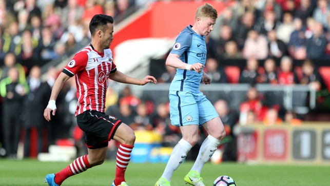 CLOSE CONTROL: Kevin De Bruyne looks to skip away from Yoshida.