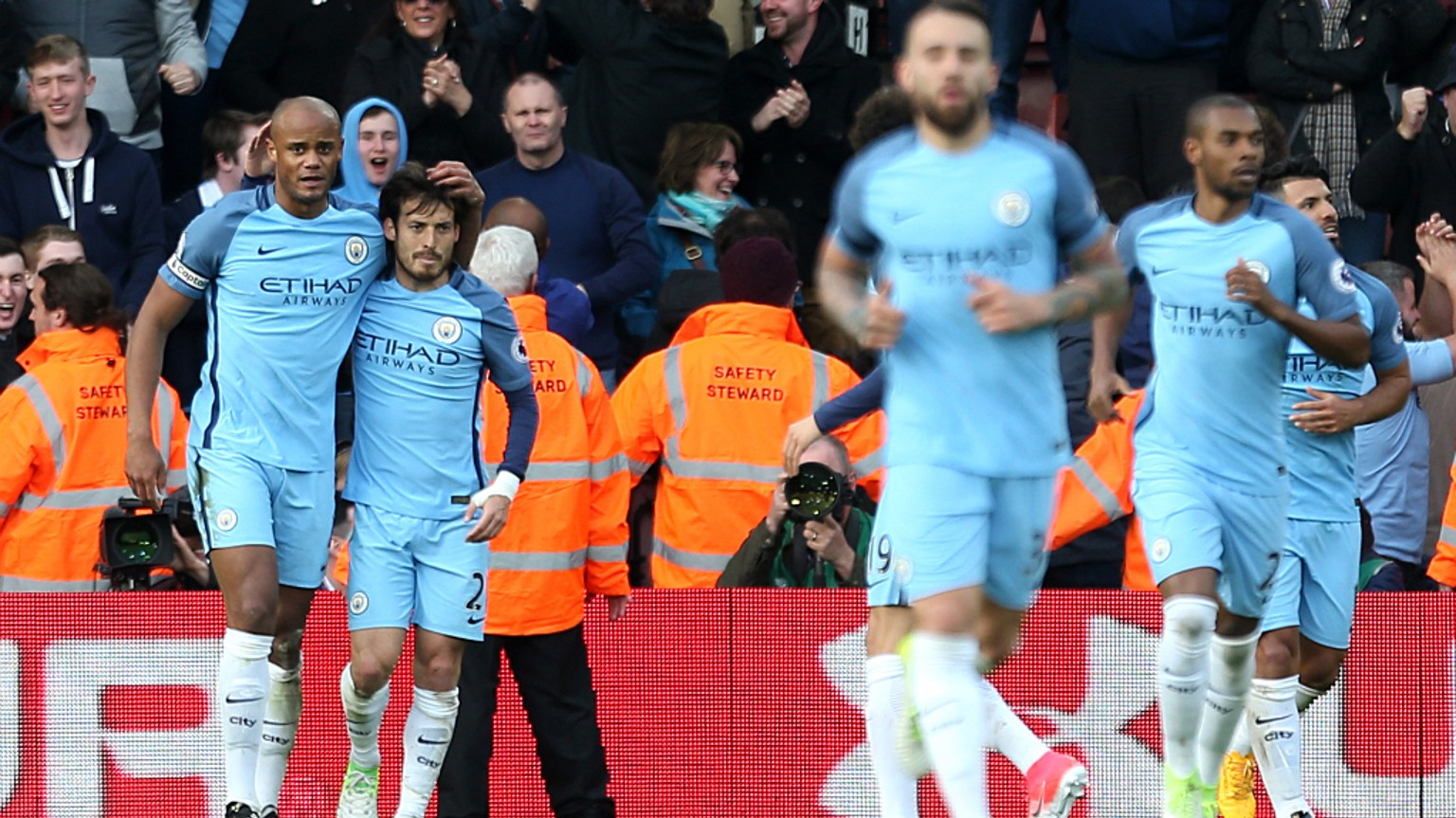DELIGHT: Silva congratulates the City captain after breaking the deadlock with a fine header.