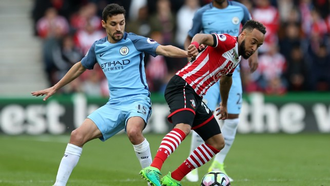 BATTLE: Jesus Navas looks to intercept the ball from Nathan Redmond.
