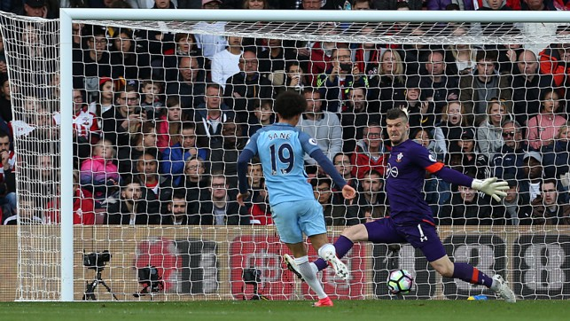 THROUGH THE LEGS: Sane slots the ball past Forster after a wonderful passing sequence leading to the goal.