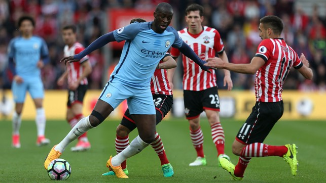 BEAT THE MAN: Toure looks to take on Tadic.
