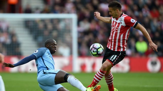 NO HOLDING BACK: Toure and Tadic commit to win possession.