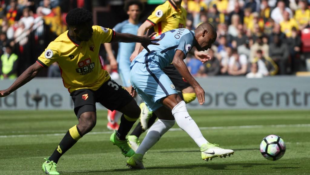 BATTLE: Fernandinho competes for possession