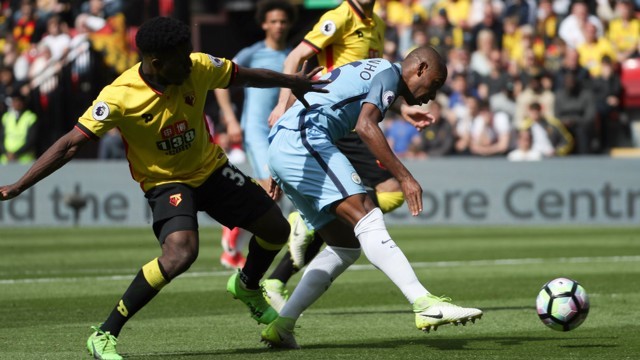 BATTLE: Fernandinho competes for possession
