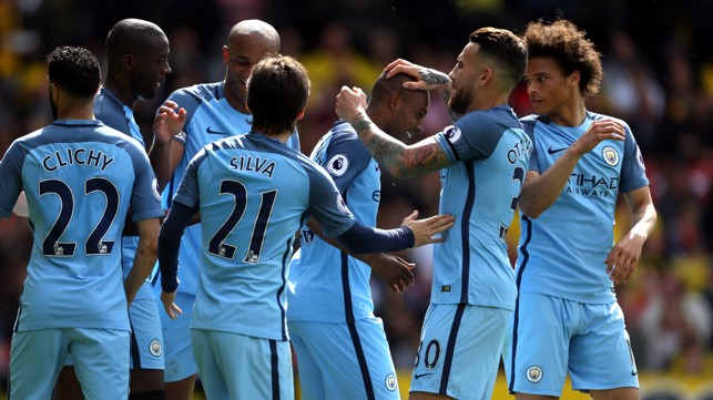 ALL WRAPPED UP: Fernandinho celebrates with his team-mates after netting City's fourth goal
