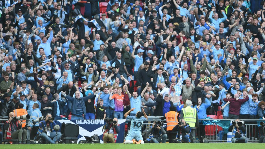GET IN! City supporters celebrate Aguero's goal