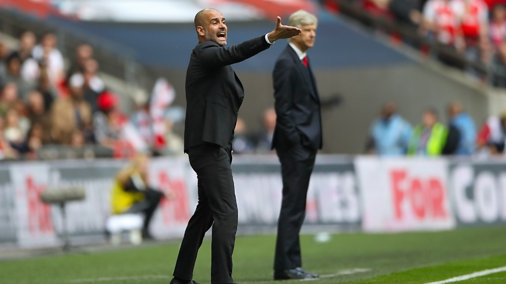 GIVING ORDERS: Pep and Wenger on the touchline.