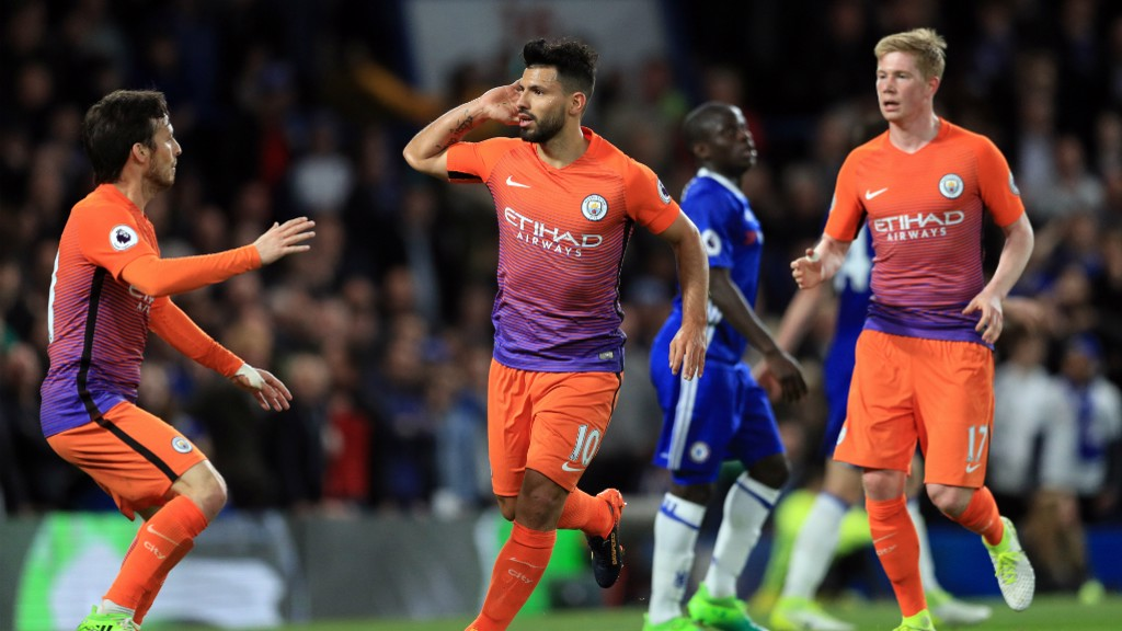 BACK IN IT: Aguero celebrates his equalizer - goal number 27 for the season.