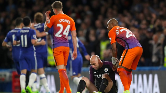 ON YOUR FEET: Fernandinho helps Caballero up after Edin Hazard restored the hosts lead