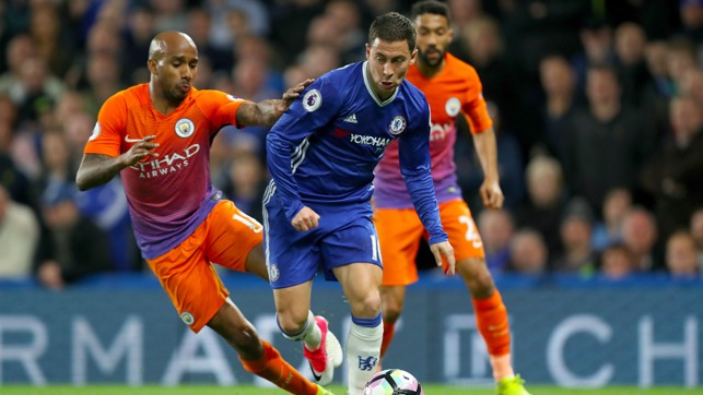 BATTLE: Delph looks to deny Hazard the chance to break.