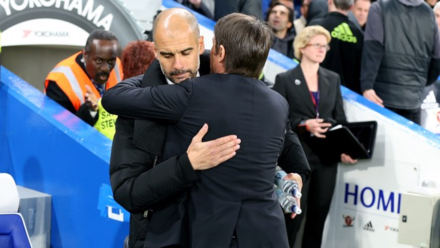 CALM BEFORE THE STORM: Pep and Conte exchange a pre-match embrace.