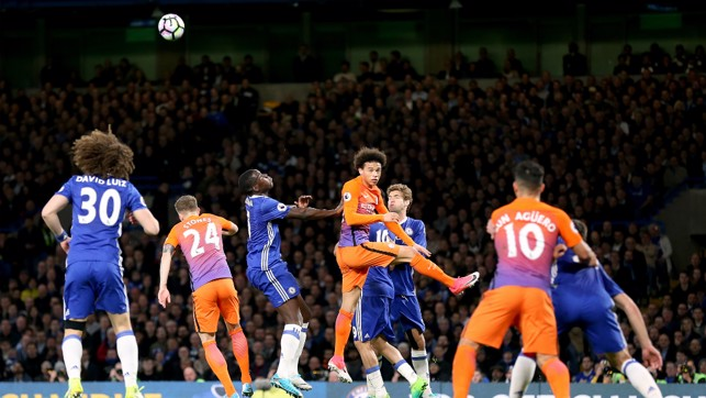 GET UP: Sane beats Zouma to the header