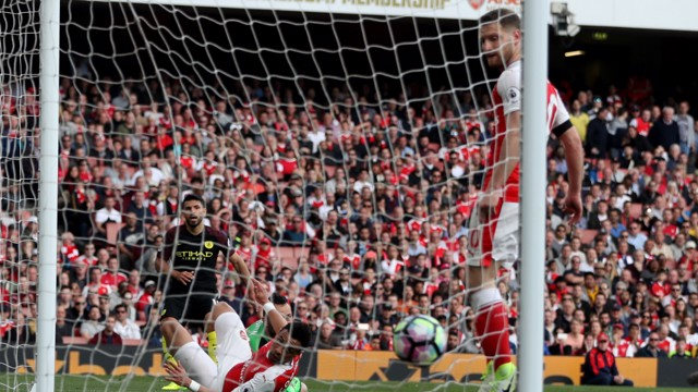 INSTANT REPLY: Aguero restores City's lead after Walcott's equaliser moments before.