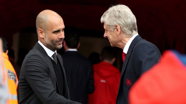 RESPECT: Pep Guardiola and Arsene Wenger exchange a pre-match handshake.