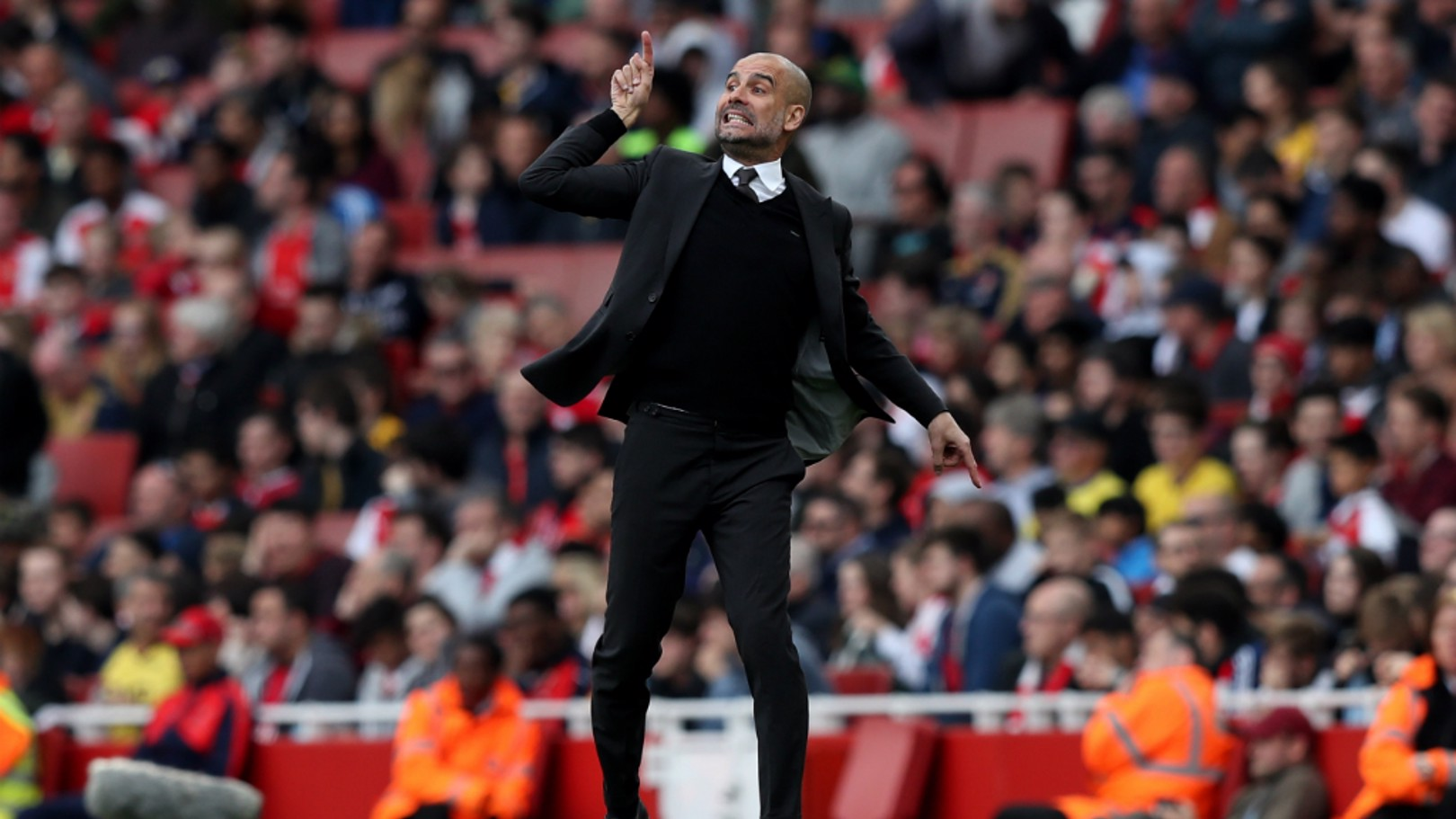 PASSION: Pep Guardiola gestures to his team from the touchline
