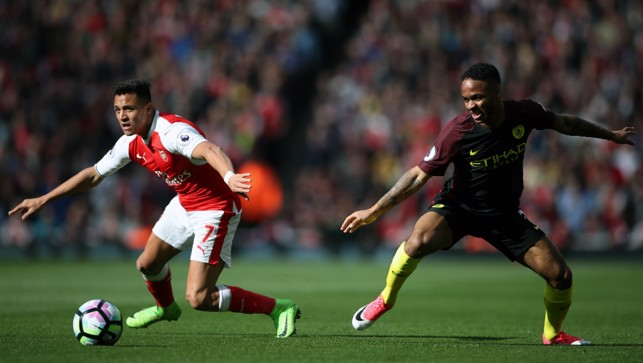BATTLE: Sterling and Sanchez compete for possession