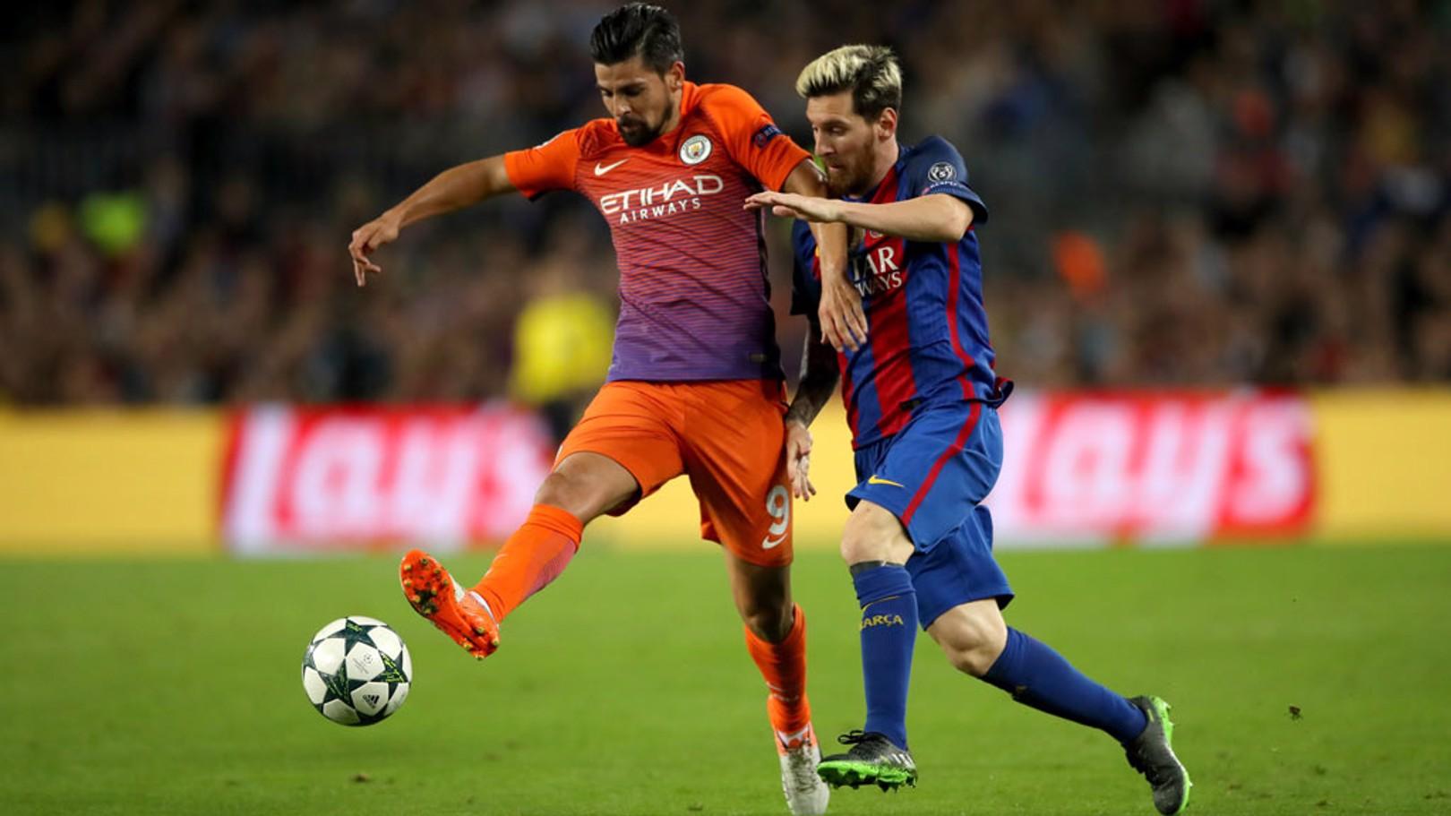 COMPETE - Manchester City's Nolito and Barcelona's Lionel Messi compete for the ball