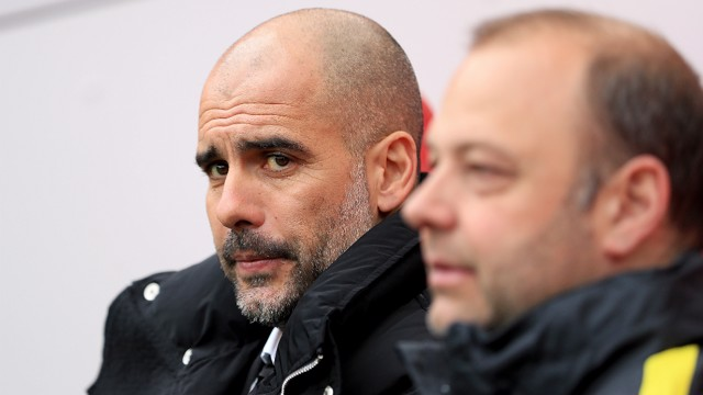 BOSS LOOKS ON : Pep Guardiola watches on at the Riverside.