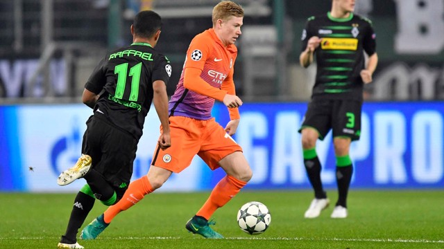 ON THE BALL: Kevin De Bruyne breaks through Gladbach's midfield line