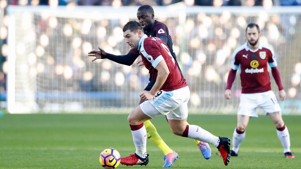 BATTLE - Yaya Toure battles for the ball  with Sam Vokes