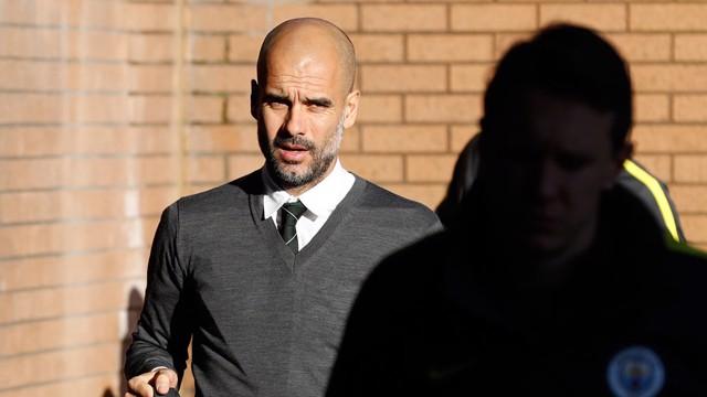 ARRIVAL: Guardiola steps off the coach