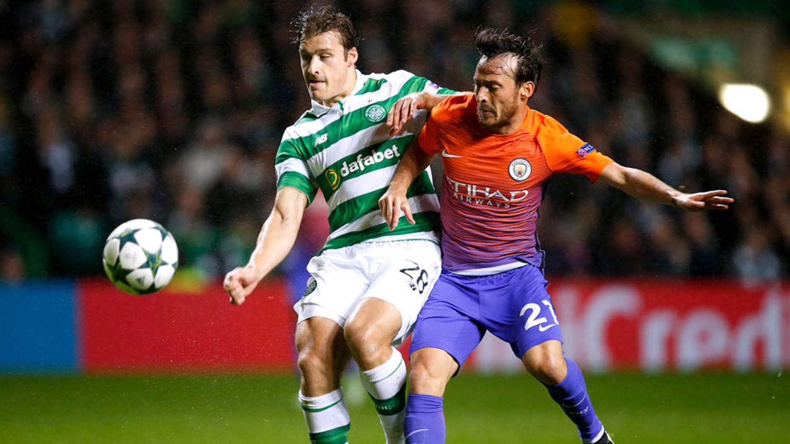 BATTLE: Manchester City's David Silva and Celtic's Erik Sviatchenko battle for the ball