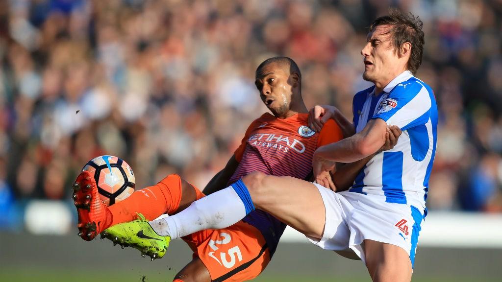 CHALLENGE: Fernandinho and Whitehead battle for the ball