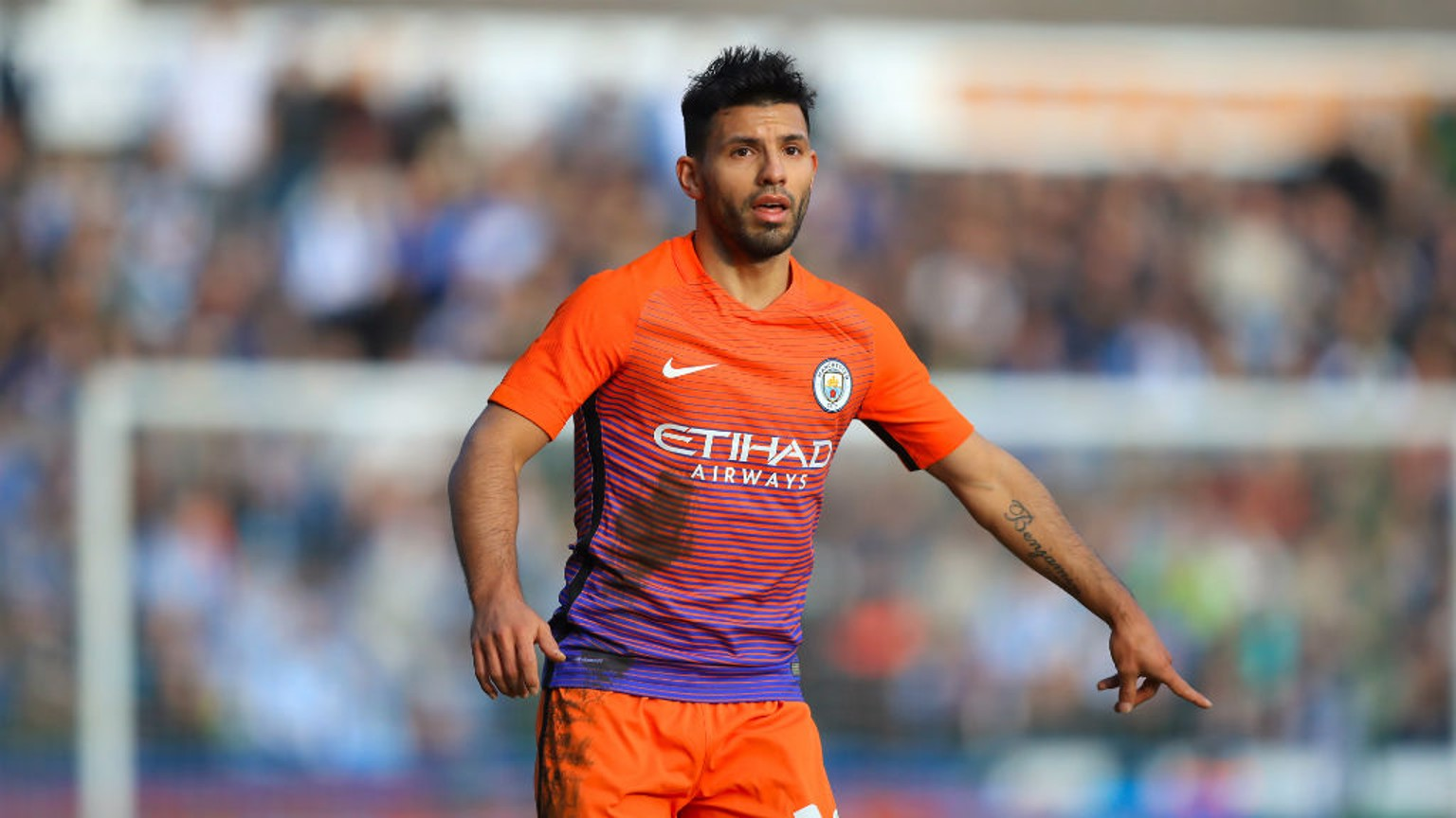 GLORIOUS ORANGE: Aguero tells a teammate exactly where he wants the ball