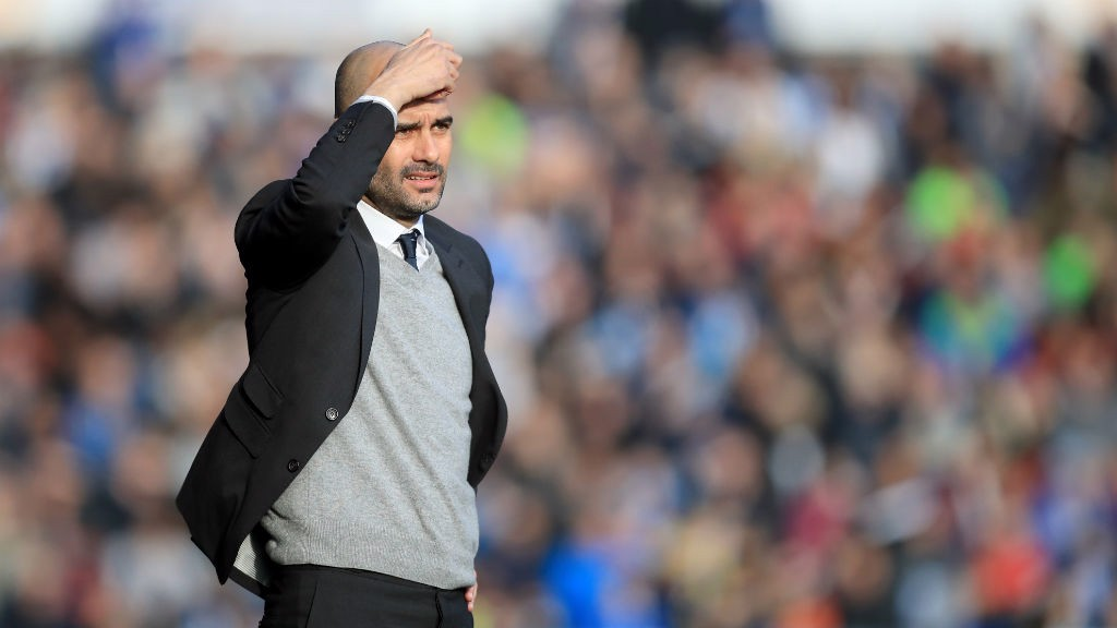 HEAD SCRATCHER: Pep watches on from the touchline