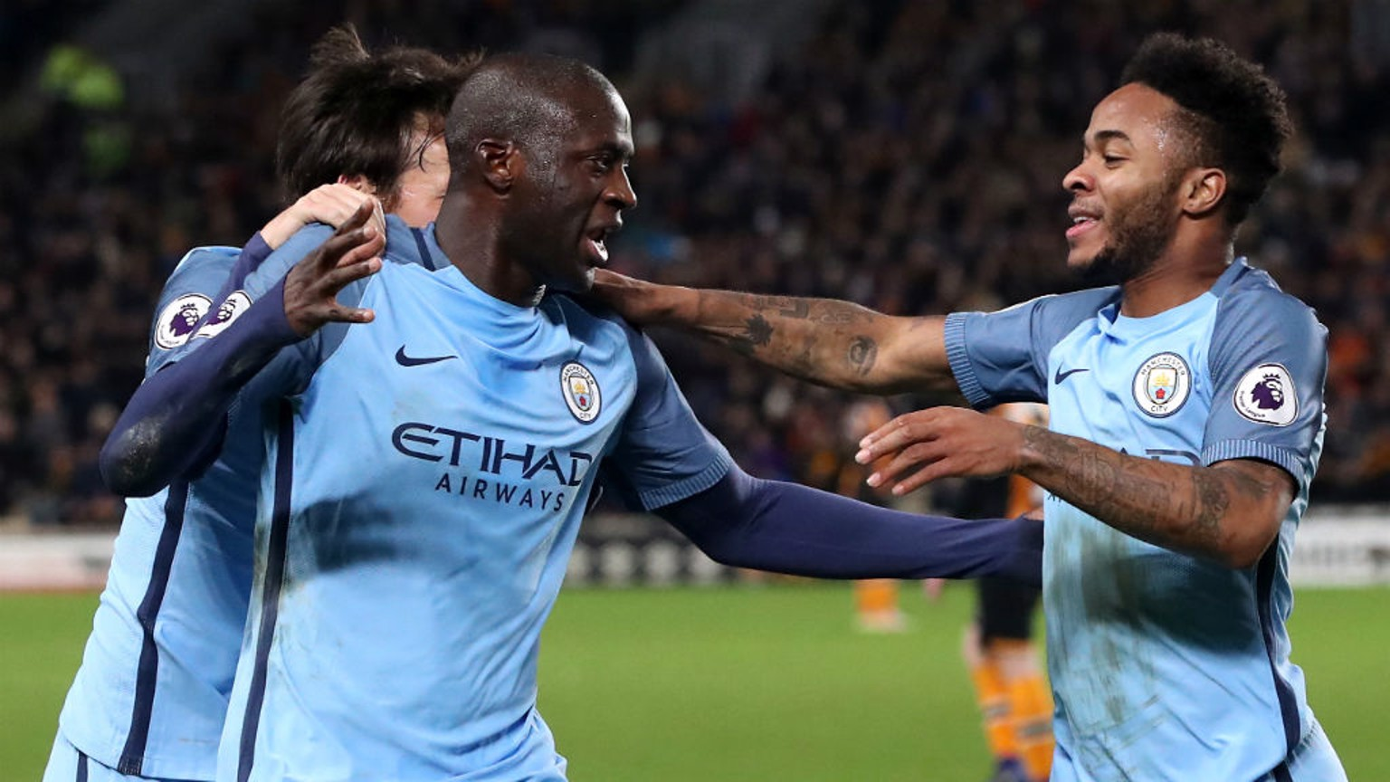 GET IN: Yaya Toure, Raheem Sterling and David Silva enjoy the moments after the Ivorian's opener