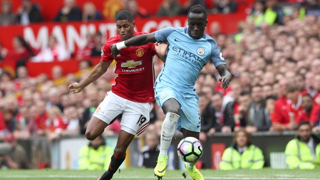 RIGHT ON: Bacary Sagna shields the ball from Marcus Rashford