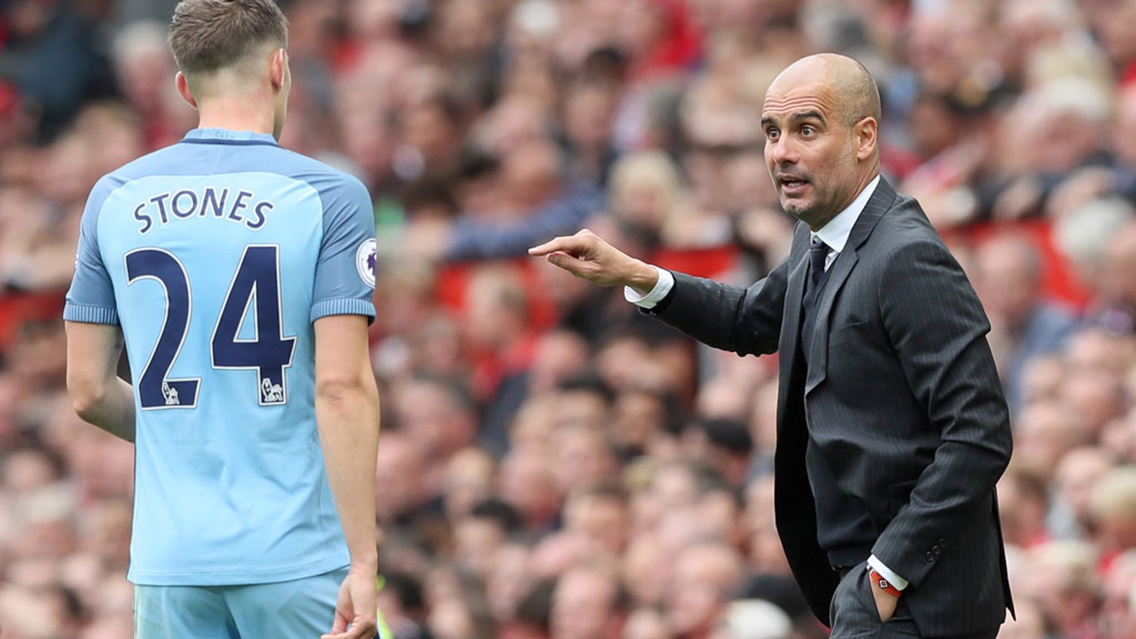 PEP GUARDIOLA: Giving instructions to John Stones