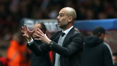 ON THE TOUCHLINE: Pep gives instructions to his players