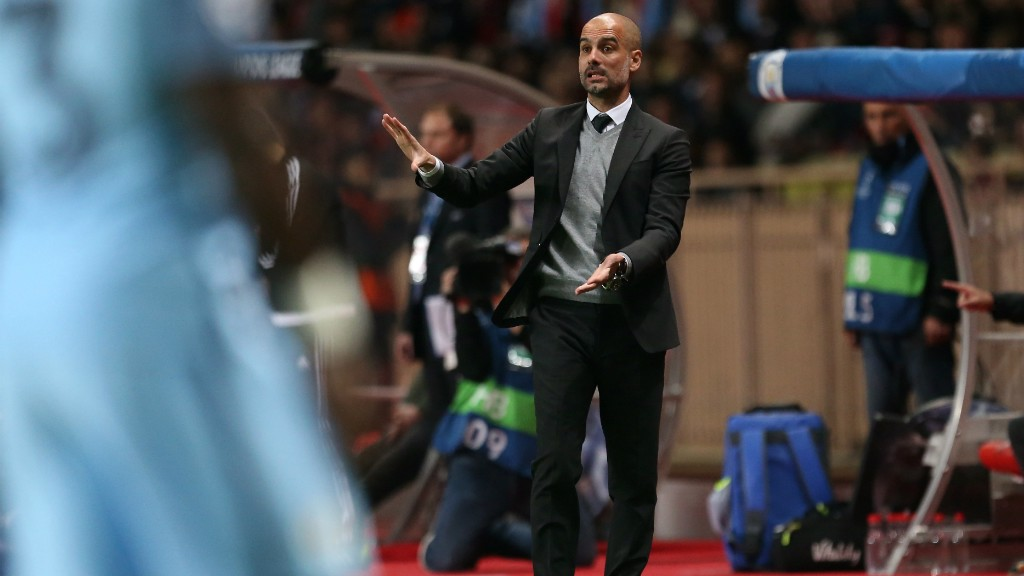 THE BOSS: Pep watches on in the early stages at the Stade Louis II.