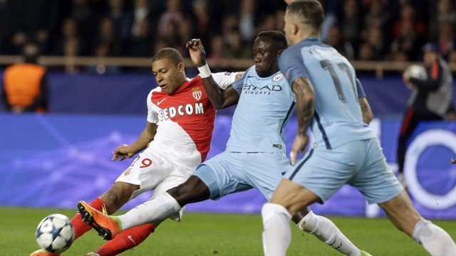 FULL STRETCH: Bacary Sagna challenges Kylian Mbappe