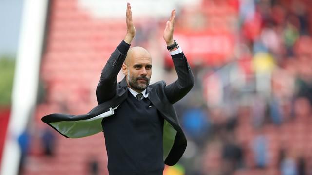 WE'VE GOT GUARDIOLA: The City boss applauds the Blue faithful