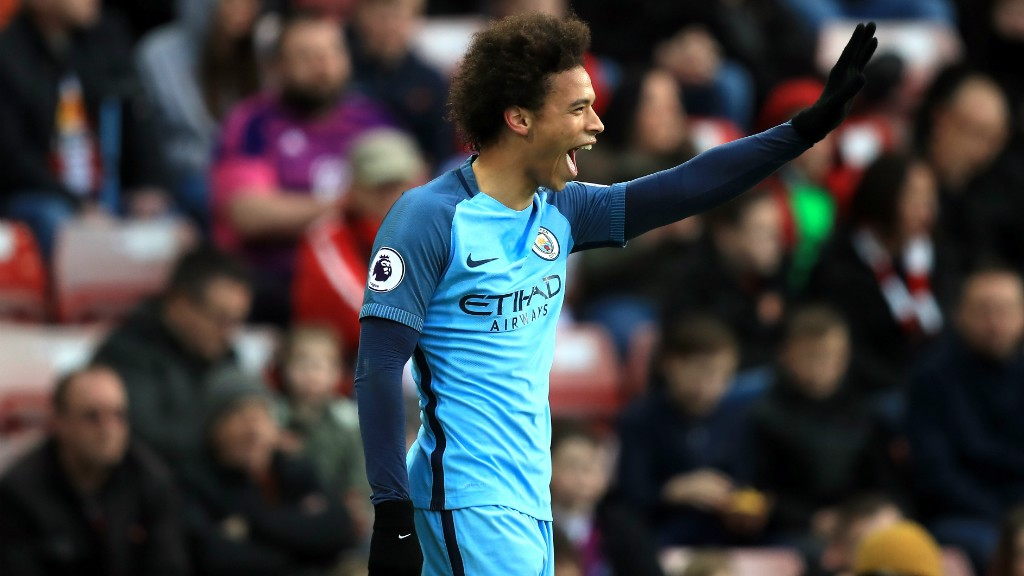 CELEBRATION TIME: Sane is on the lookout for David Silva after another superb assist.