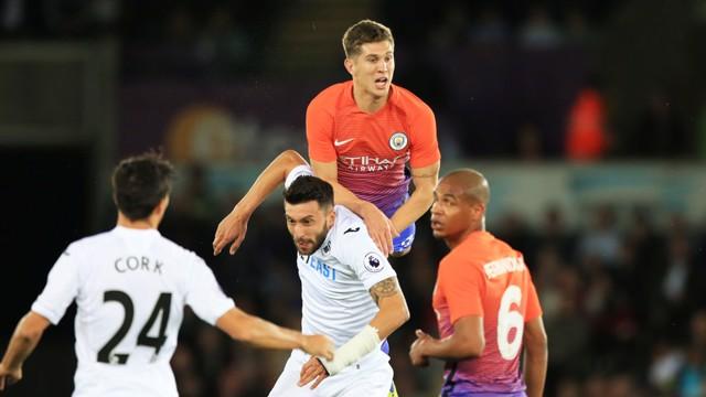 John Stones heads the ball